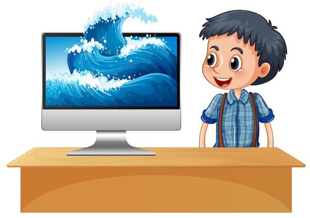 화면에 파도가 있는 컴퓨터 옆에 있는 행복한 소년