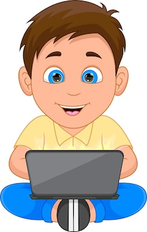 Happy boy playing with a laptop on white background