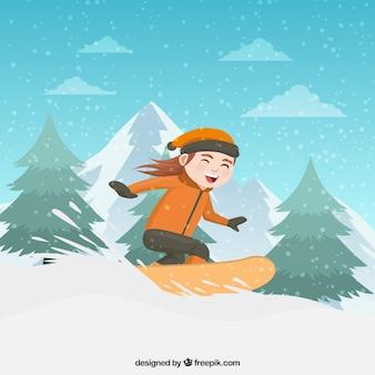 Счастливый мальчик катается на сноуборде
