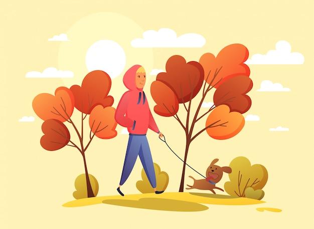 秋の公園の図に犬と一緒に幸せな少年