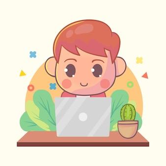 노트북 만화에서 작업하는 행복 한 소년