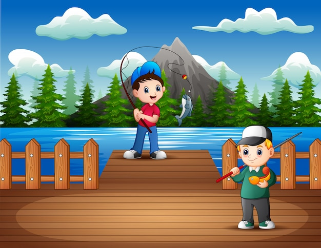 Happy boys fishing on the wooden pier