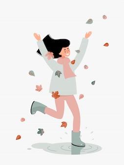Счастливая брюнетка женщина прыгает и улыбается с листьями