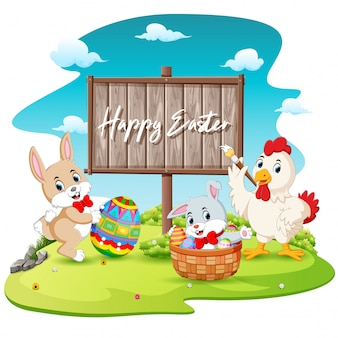 Happy bunny and rooster painting egg with blank wood sign background