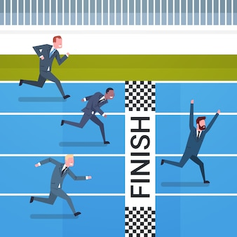 Happy business man crossed to finish line leadership and competition concept