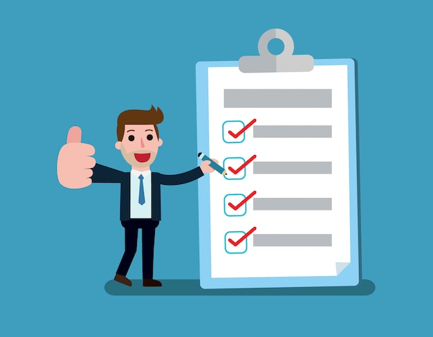 Happy businessman holding a pencil looking at completed checklist on clipboard