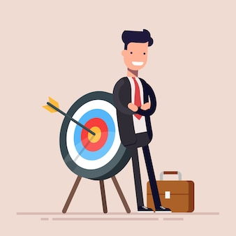 Happy businessman or manager is standing near the target. the arrow hit the target exactly. flat illustration in cartoon style.