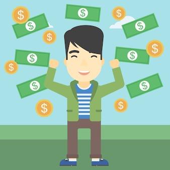 Happy businessman under money rain