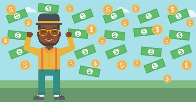 Happy businessman under money rain.