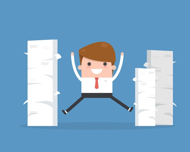 Happy businessman and a mountain of documents.