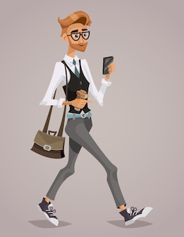 Happy businessman with a briefcase looking at his smartphone