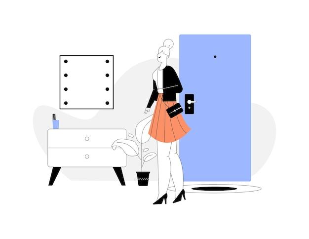 행복 한 사업가 직장에서 집으로 돌아갑니다. 아늑한 복도에 서있는 여자. 세련된 현관 인테리어, 거울, 옷장, 식물.