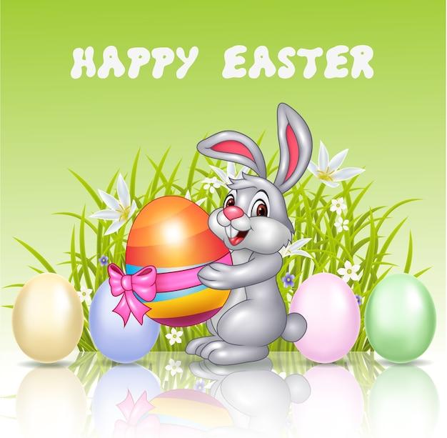 Happy cartoon bunny holding an easter egg