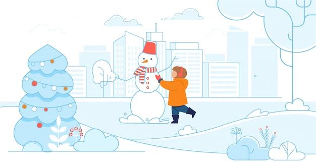 Happy child making a snowman