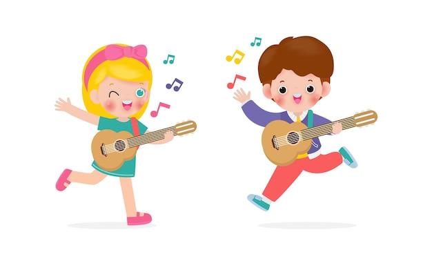 ギターを弾く幸せな子供たちの男の子と女の子