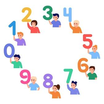 서클에서 행복한 아이들은 숫자를 잡고 어린 아이들은 숫자 수학 교육을 배웁니다.