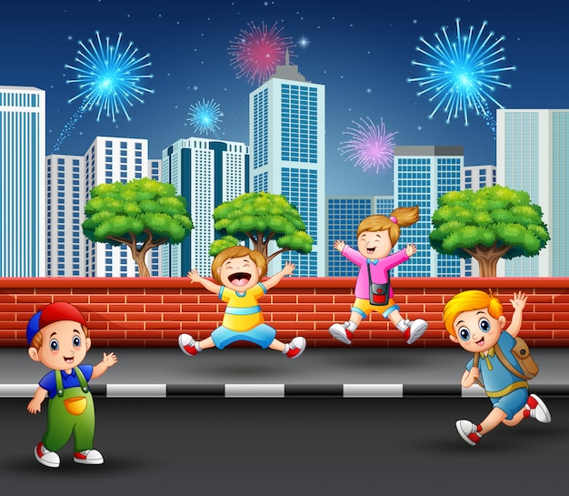 Happy children jumping and laughing on the street sidewalk
