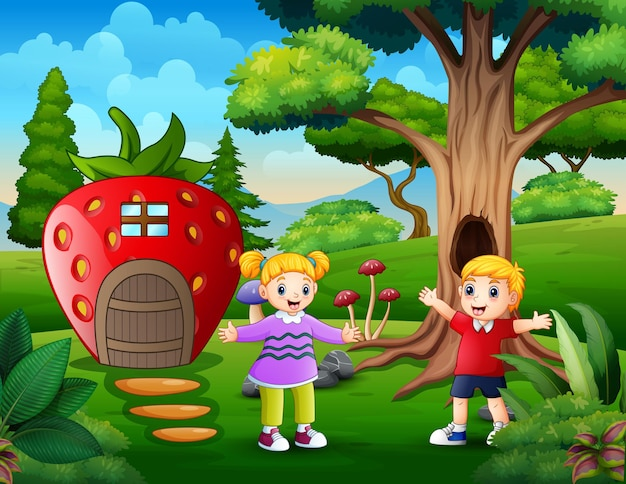 Happy children playing by the fantasy strawberry house