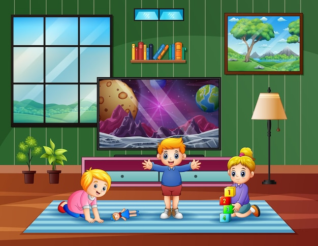 Happy children playing in front of the tv