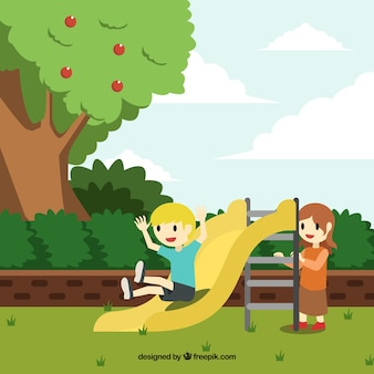 Happy children playing on a toboggan