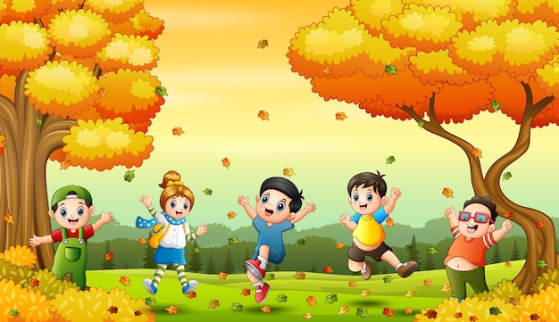 Happy children playing with fallen leaves