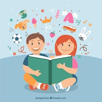 Happy children reading a book