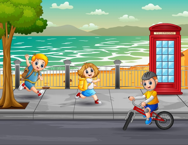 Happy children running and cycling in the street