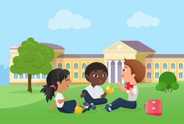 Happy children spend fun time together after school lessons sitting on picnic on lawn