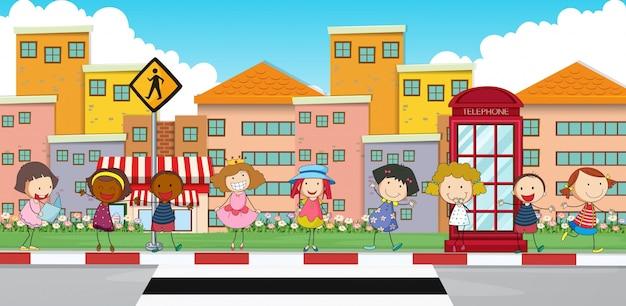 Happy children standing on sidewalk