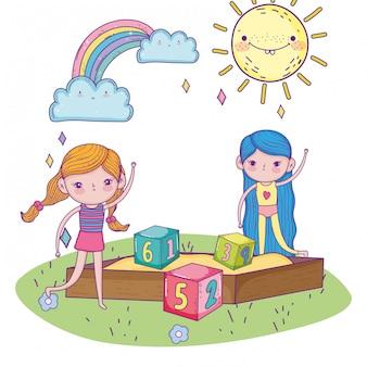 幸せな子供の日、番号ブロック公園で砂場の女の子
