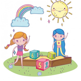 Happy childrens day, girls in sandbox with numbers blocks park