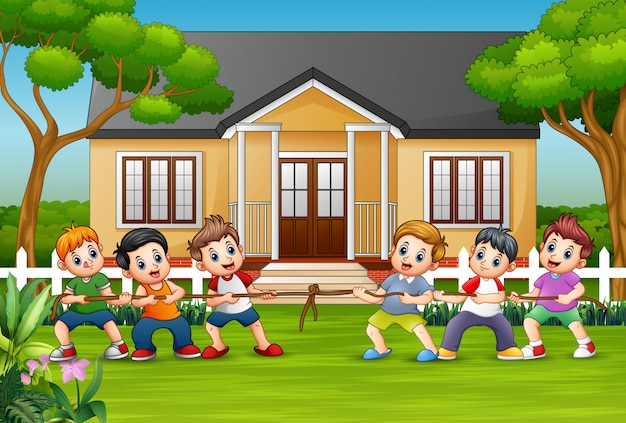 Happy childrens playing tug of war in front a house