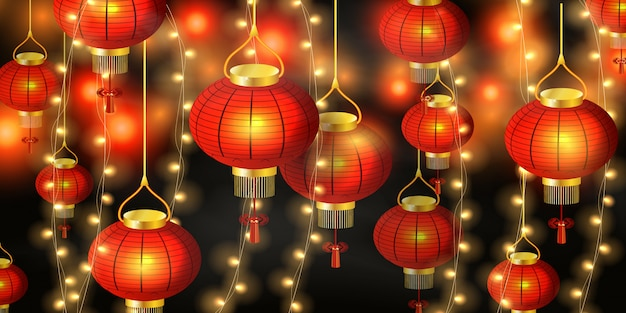 Happy chinese new year. chinese new year festive red lanterns in china town fairy lights at night.