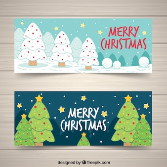 Happy christmas banners with hand drawn trees Free Vector