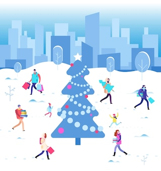 Happy christmas holiday. winter people walking at city christmas tree. family on winter vacation