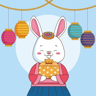 토끼를 들어 올리는 선물과 등불에 매달린 행복한 추석 축제