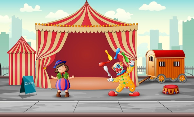 Happy clowns performance in the circus tent