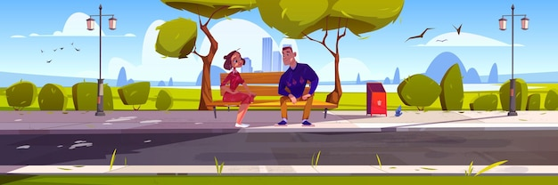 Happy couple on date in city park public garden with man and woman sitting on wooden bench