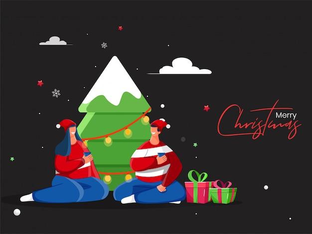 Счастливая пара, наслаждаясь напитком с подарочные коробки и декоративные елки на черном для празднования рождества.