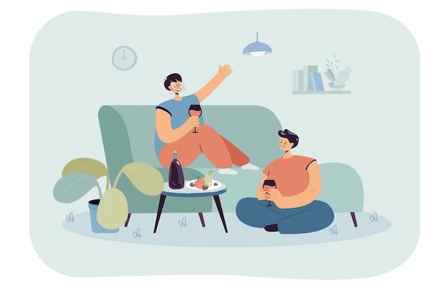 家でロマンチックな夜を楽しんで幸せなカップル