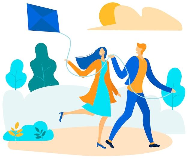 公園の図に凧を飛んで幸せなカップル