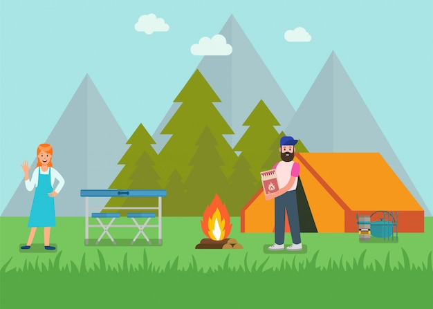 Happy couple in forest goods for picnic ad