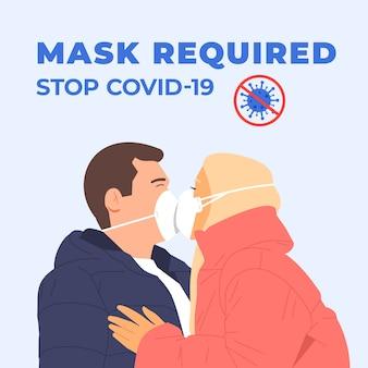 幸せなカップルがマスクでキスします。