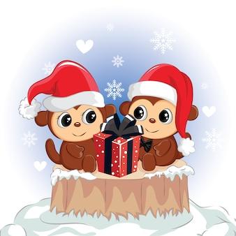 Счастливая обезьяна пары с красной подарочной коробкой. милая обезьяна на рождество.