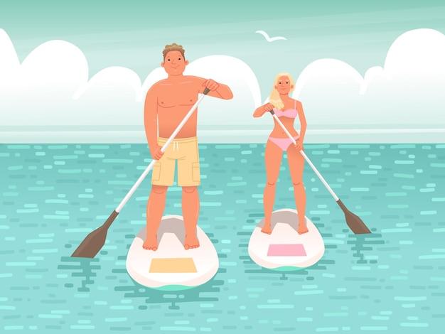 젊은 사람들의 행복한 커플이 스탠드업 패들 보드 a에서 수영
