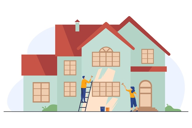 Happy couple painting house facade
