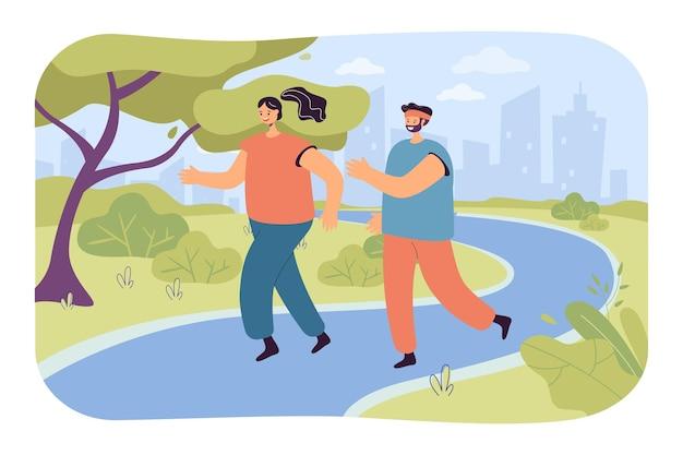 公園で一緒に走っている幸せなカップル