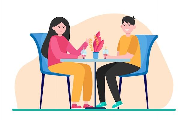 Счастливая пара сидит в кафе и пьет пузырьковый чай