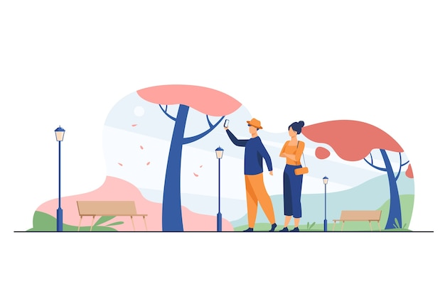 Happy couple taking selfie in autumn park. fall, love, season flat vector illustration. date and weekend