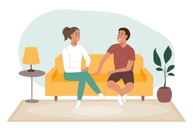 거실에 있는 소파에 앉아 이야기를 나누는 행복한 커플 남자와 여자는 함께 시간을 보낸다